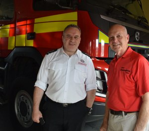 During my visit, NIFRS District Commander John Bacon (left) showed me their regular fire appliances (apparatus) and specialty units. (Photo/Robert Rielage)