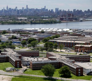 NYC lawmakers voted to approve a plan to close Rikers and replace it with four smaller jails throughout the city. (Photo/AP)
