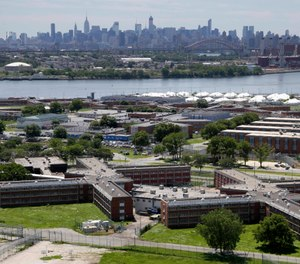 New York City lawmakers are considering a plan to close the Rikers Island jail complex and replace it with four smaller jails. (Photo/AP)