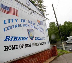 The president of the Correction Officers Benevolent Association said the two cases may signal a potential outbreak at the jail. (Photo/AP)