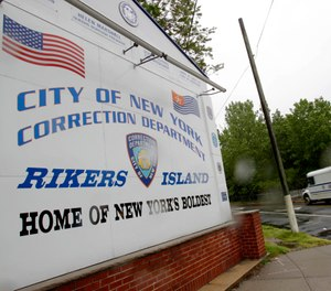 Six Rikers Island corrections officers have been accused of taking thousands of dollars in bribes to smuggle drugs to inmates. (Photo/AP)