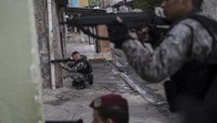 Olympic officer fatally shot after wrong turn into slum