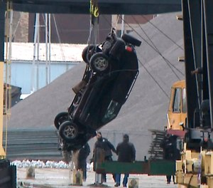 This Jan. 1, 2019 screen shot from WISN-TV shows authorities pulling out an SUV from the Kinnickinnic River, a day after it crashed into the river during a police chase. A toddler, her young mother and a man died when their vehicle drove into a frigid river while being chased by the Milwaukee Police.