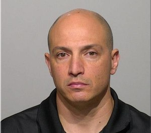 Milwaukee Fire Lt. Robert Olson, 44, was arrested Nov. 20 and faces a sexual assault charge for alleged offenses against a 14-year-old girl. (Photo/Milwaukee Sheriff's Department Facebook)
