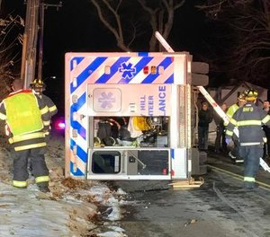 Three EMS providers and another driver sustained minor injuries in a rollover ambulance crash Thursday night. (Photo/Police Department of Rocky Hill Facebook)
