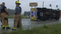 4 injured when truck hits ambulance