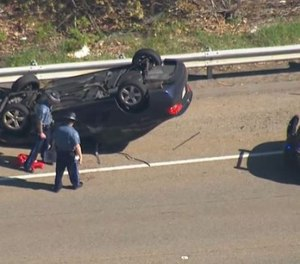 A Massachusetts trooper and three others were injured during a rollover crash. (Photo/TNS)