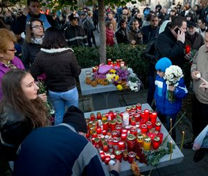 As the nation entered its second day of mourning, thousands paid their respects at the Colectiv nightclub in Bucharest. (AP Photo/Vadim Ghirda)
