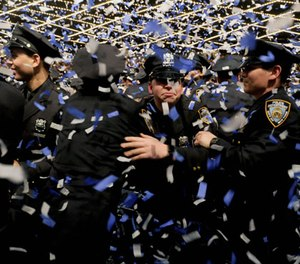 It's easy to be over-invested in a career in law enforcement, especially early on in your career. (Photo/Star Max via AP)