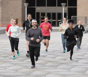 Mario Giorno (middle) and other members of the Annenberg (Lunchtime) Running Club meet three times a week at the plaza at 36th Street and Locust Walk in University City.