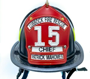 A Lubbock Fire Rescue (LFR) helmet signed by Mahomes is being auctioned off on eBay.com to benefit the families of Lubbock Police Department Officer Nicholas Reyna and LFR Lt.-Paramedic Eric Hill, who were killed in a roadway crash on Jan. 11, as well as injured Firefighter-Paramedic Matt Dawson, who was critically injured in the incident, FOX 4 KC reported. (Photo/eBay)