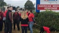 Mass. medics, EMTs protest low wages, burnout outside AMR headquarters
