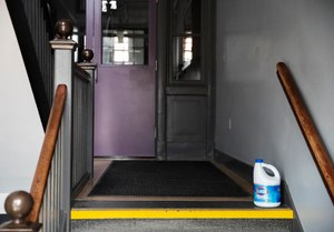 A bottle of bleach sits on the steps of Saint Raphael Academy in Pawtucket, R.I. Image: AP Photo/David Goldman
