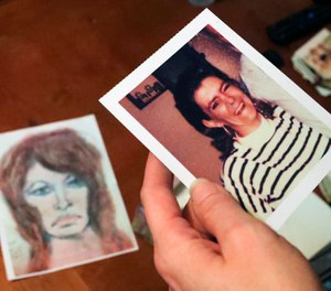 In this Thursday, Oct. 10, 2019 photo, Tonya Maslar holds an old photograph of her mother Roberta Tandarich taken before her death in 1991 in Ravenna, Ohio. (Jeff Lange/Akron Beacon Journal via AP)
