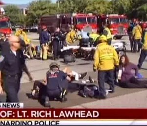 First responders attend to people outside a Southern California social services center in San Bernardino.