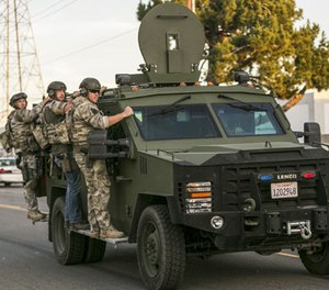 In this Dec. 2, 2015 file photo authorities search an area near where police stopped a suspected vehicle in San Bernardino, Calif. State lawmakers want to see if lessons can be learned from the way first-responders reacted to the San Bernardino terror attack that killed 14 people last year.