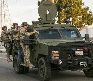 Officers respond to the attacks in San Bernardino, Calif.
