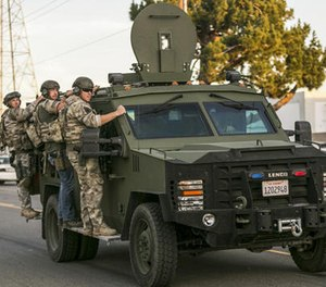 In this Dec. 2, 2015 file photo authorities search an area near where police stopped a suspected vehicle in San Bernardino, Calif. (AP Image)