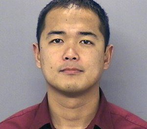 This undated file photo provided by the San Diego Police Department shows San Diego Police officer Jonathan De Guzman.