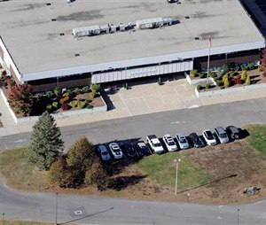 This Oct. 28, 2013 aerial photo shows the Sandy Hook Elementary School, relocated to the former Chaulk Hill School building in Monroe, Conn., after the original building in neighboring Newtown was razed following A Dec. 14, 2012, shooting rampage where 26 people were killed. A threat Wednesday, Oct. 1, 2014, led to the evacuation of the new Sandy Hook Elementary School in Monroe. The superintendent's office said the students were being moved to a nearby school where they could be picked up by their parents. (AP Photo/Jessica Hill)
