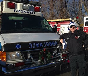Heather Lee, a paramedic student and Cromwell volunteer, prepares for the Santa Run. (Photo courtesy of Cromwell Fire Department)