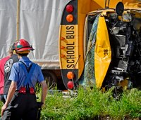 School bus flips in hit-and-run crash; 16 taken to hospital