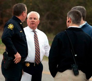 Berkeley County Sheriff Duane Lewis, second from left, talks with sheriff department personnel after deputies and other law enforcement agents responded to an active shooter situation in Huger, S.C. (Brad Nettles/The Post And Courier via AP)
