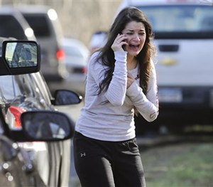 In this Dec. 14, 2012, file photo, Carlee Soto uses a phone to get information about her sister, Victoria Soto, a teacher at the Sandy Hook elementary school. (AP Image)