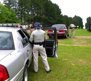 In this May 11, 2017 file photo trainees practice pulling over a car in an exercise at the South Carolina Criminal Justice Academy in Columbia, S.C.