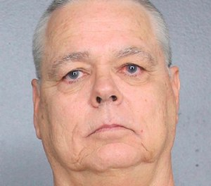 This undated photo provided by the Broward County, Fla., Sheriff's Office shows Scot Peterson.