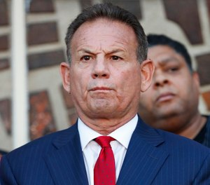 In this Jan. 11, 2019, photo, suspended Broward County Sheriff Scott Israel listens to comments by his attorney at a news conference after new Florida Gov. Ron DeSantis suspended Israel in Fort Lauderdale, Fla., over his handling of February's massacre at Marjory Stoneman Douglas High School. (AP Photo/Wilfredo Lee)