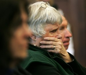 Shelia Mulligan Donovan, sister of slain Boston Police Detective John Mulligan, listens during a sentencing hearing for Terry Patterson at Suffolk Superior Court in Boston, Tuesday, Feb. 7, 2006. Prosecutors charged that Patterson was present when Sean Ellis fatally shot Mulligan in September 1993. (AP Photo/Steven Senne)