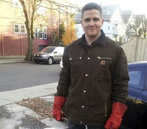 In this November 2012 file photo provided by Nicole Lynch, her brother, Sean Collier, stands in his driveway in Somerville, Mass. (AP Image)