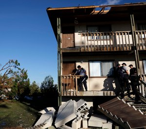 Members of an Indiana urban search and rescue team check an apartment building for residents in the aftermath of hurricane Michael in Callaway, Fla., Thursday, Oct. 11, 2018.