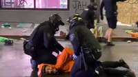 Video: Seattle officer removes colleague's knee from neck of man detained amid looting