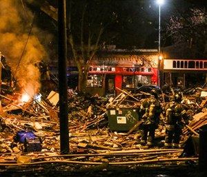 Firefighters work at the scene of a building explosion in Seattle's Greenwood neighborhood early Wednesday. (Genna Martin/seattlepi.com via AP)