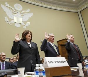 Secret Service Director Julia Pierson, left, is sworn in on Capitol Hill in Washington, Tuesday, Sept, 30, 2014, prior to testifying before the House Oversight Committee as it examines details surrounding a security breach at the White House when a man climbed over a fence, sprinted across the north lawn and dash deep into the executive mansion before finally being subdued. (AP Image)
