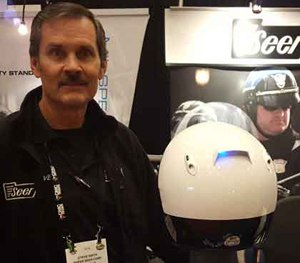 Steve Smith, President of Seer, shows off the Enhanced Motor Officer Helmet Lighting System. (PoliceOne Image)