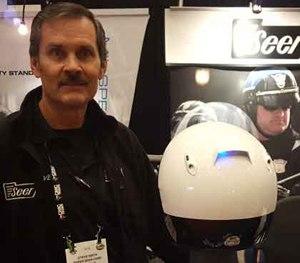 Steve Smith, President of Seer, shows off the Enhanced Motor Officer Helmet Lighting System.