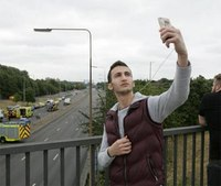 Man suspected of taking selfie at London car crash scene
