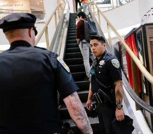San Francisco Police Officers Nick Parkin, right, and Cory McDowell look for a person causing a disturbance in the Westfield Mall in San Francisco, California, on Wednesday, March 4, 2020. (Photo/TNS)