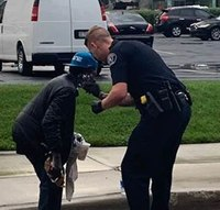 Cop helps homeless man trying to shave in puddle