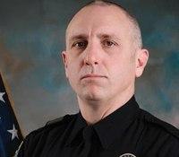 SWAT officer shot in head serving warrant dies