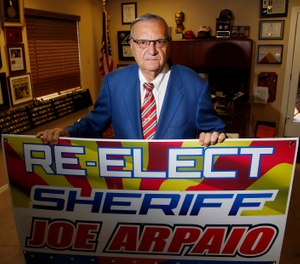 Former Maricopa County Sheriff Joe Arpaio poses for a picture in his office as he is running for the position of Maricopa County Sheriff again, Wednesday, July 22, 2020, in Fountain Hills, Ariz. (AP Photo/Ross D. Franklin)