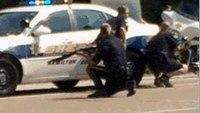 Officer shot, 4 Marines and gunman dead in shootings