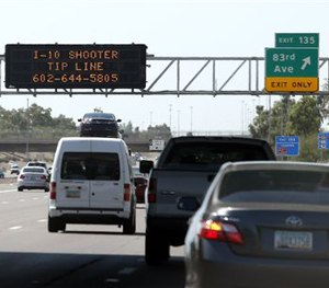 A sign still displays a shooter tip line above Interstate 10, Friday, Sept. 11, 2015, in Phoenix. (AP Image)