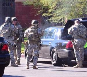 SWAT arrives on scene.