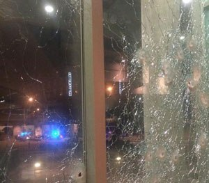 Photo tweeted by Dallas Police Department after shooting shows damage to windows. (Dallas Police Department Image)