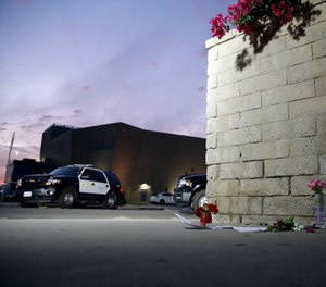 Flowers are placed in front of Saugus High School in the aftermath of a shooting on Thursday, Nov. 14, 2019, in Santa Clarita, California. (Photo/Marcio Jose Sanchez/AP)