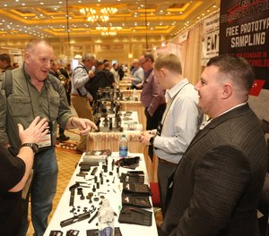 Suppliers talk with attendees at the 2019 SHOT Show in Las Vegas, Nevada.